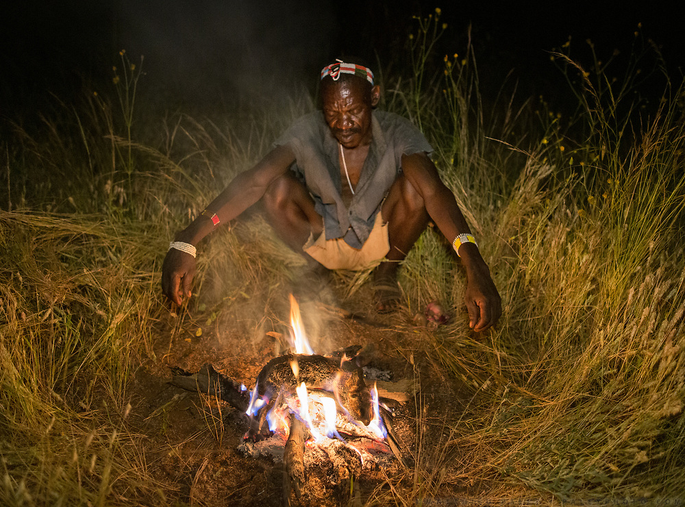 Mno cooking a Hyrax on the fire, after he hunted it, in the Gideru mountains.