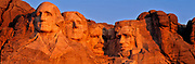 Sunrise light warms the presidential faces at Mount Rushmore National Monument, in the Black Hills of South Dakota.