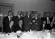 22/06/1965<br /> 06/22/1965<br /> 22 June 1965<br /> Presentation to Mr. Montague at the Shelbourne Hotel, Dublin. At a private dinner in the Shelbourne Hotel, a group of Dublin Businessmen made a presentation to Mr. F.J. Montague, retiring Manager of the O'Connell Street Branch of the Northern Bank Ltd. Picture shows Mr. W. Davidson, (left) Director, Northern Bank Ltd. (Belfast) handling over the gift to Mr. F.J. Montague. Included are some of those present at the presentation. Sponsors wereMrs E.F. Robertson; Mrs Shillington; Mr. Denis A. McArdle, Sol.; Mr. Joseph J. Kiernan, Sol.; Mr. David Bell, Sol.; Mr. R.A. Dagg, Contractor; Mr. P.J. Neylon, Architect; Mr. O. Wallace, Contractor; Messrs Mahons Printing works; N. Jameson and Co., Jeweller; Ordman, Marcus and Co.; Jefferson Smurfit and Sons Ltd.; Mckenna Distributors Ltd.; The Educational Co. of Ireland Ltd.; E. McCormock and Co. Ltd.; P.j. Matthews Ltd.; Collen Bros. (Dublin) Ltd.; William Street Warehouse Ltd.; Restamond Products Ltd. and the Apex Manufacturing Co. (1935) Ltd..