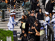 26 OCTOBER 2017 - BANGKOK, THAILAND:  People leave sandalwood flower offerings for the late king during the funeral ceremony for Bhumibol Adulyadej, the Late King of Thailand. The king died on 13 October 2016 and was cremated 26 October 2017, after a mourning period of just over one year. The revered monarch was the longest reigning king in Thai history and is credited with guiding Thailand through the turbulent latter half of the 20th century.   PHOTO BY JACK KURTZ