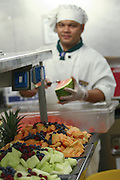 Cheff prepares fruit salad