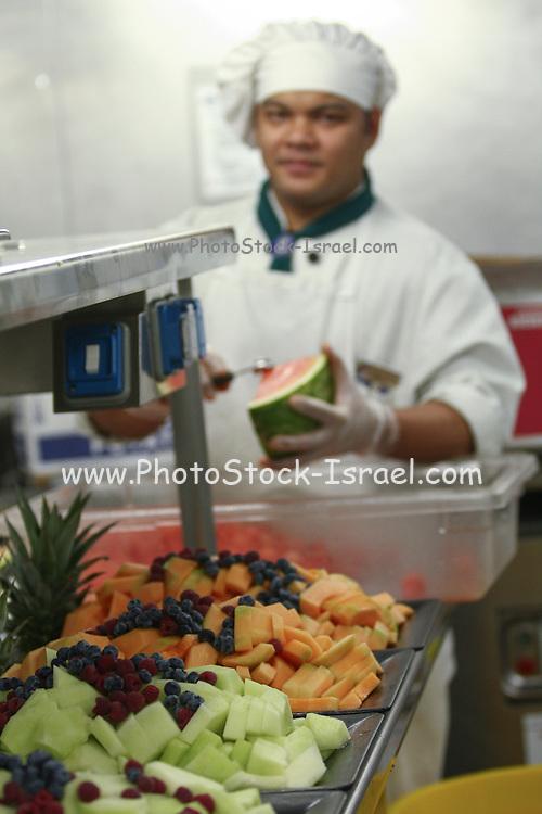 Cheff prepares fruit salad