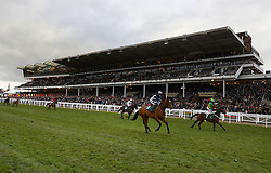 Runners and riders go to post for the Trull House Stud Mares Novices' Hurdle during St Patrick's Thursday of the 2018 Cheltenham Festival at Cheltenham Racecourse.