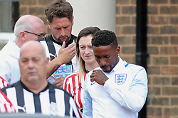 Jermain Defoe (right) outside St Joseph's Church in Blackhall, County Durham. where the funeral of Bradley Lowery, the six-year-old football mascot whose cancer battle captured hearts around the world, took place.