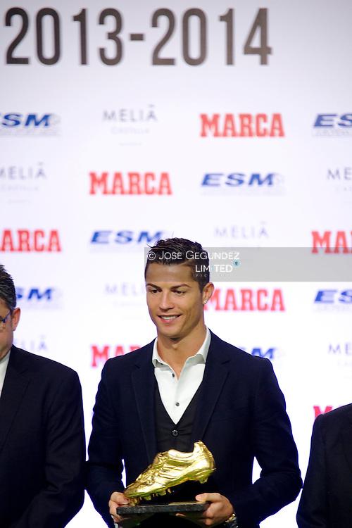 Portuguese Real Madrid Player Cristiano Ronaldo receives the Golden Shoe 2013-2014 at Hotel Melia Castilla on November 5, 2014 in Madrid