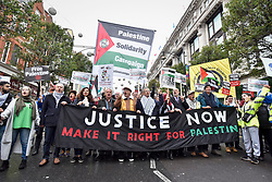 "© Licensed to London News Pictures. 04/11/2017. London, UK.  Demonstrators take part in ""Justice Now: Make It Right For Palestine"", from Grosvenor Square marching down Oxford Street to a rally in Parliament Square, demanding justice and equal rights for Palestinians on the centenary of the Balfour Declaration.  Photo credit: Stephen Chung/LNP"