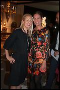 MIEKA SYWAK (L) and REBECCA DAVIES (R) at the preview of LAPADA Art and Antiques Fair. Berkeley Sq. London. 23 September 2014.