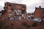 Demolition of the Kingsway, a derelict former cinema in Kings Heath, Birmingham, United Kingdom. The Kingsway cinema built in the 1920s and later housed a bingo hall, closed its doors in 2010 and was burnt out in a fire in 2011, destroying 80 per cent of its interior. Now demolished there are plans to turn this into residential apartments.