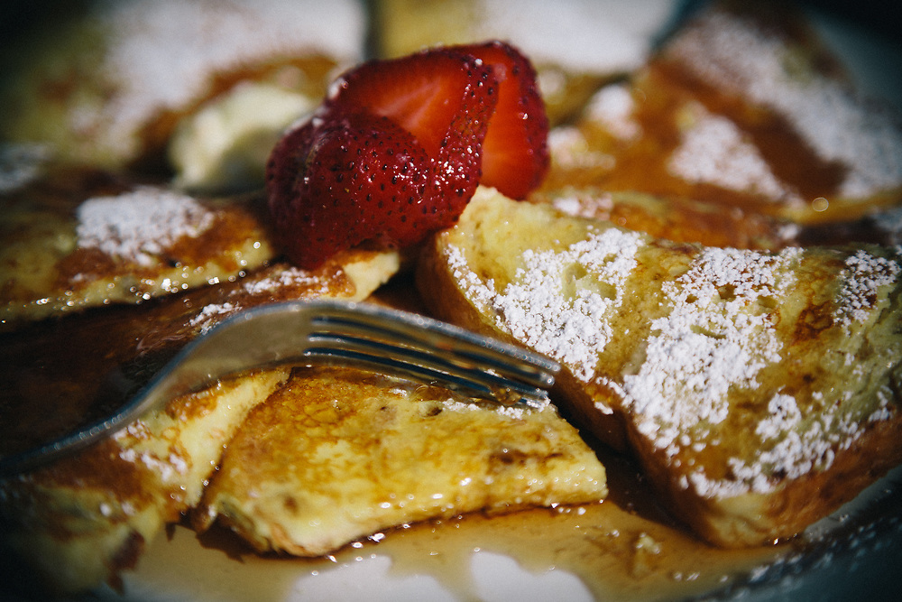 Jay Goodrich has French Toast for breakfast before riding on the Kenai Penninsula in Seward, Alaska.