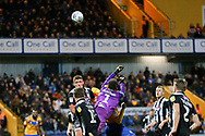 Grimsby Town goalkeeper James McKeown (1) punches the ball clear during the EFL Sky Bet League 2 match between Mansfield Town and Grimsby Town FC at the One Call Stadium, Mansfield, England on 4 January 2020.