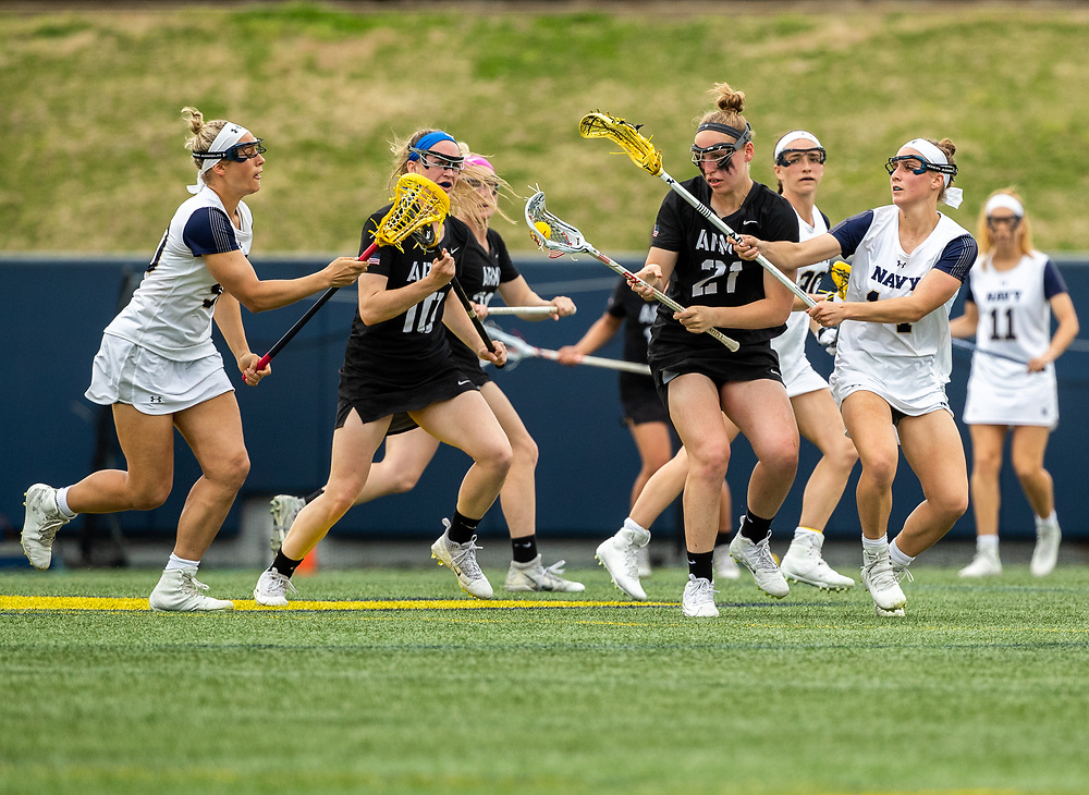 Caroline Raymond of the Army Black Knights and Annalise Heyward of the Navy Midshipmen during an NCAA Division I women's lacrosse game between the Army Black Knights and Navy Midshipmen at Navy Marine Corps Memorial Stadium on April 13, 2019 in Annapolis, MD.