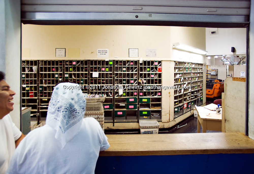 Post office customers in Miami, Florida. WATERMARKS WILL NOT APPEAR ON PRINTS OR LICENSED IMAGES.