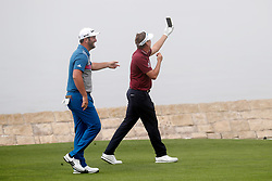June 12, 2019 - Pebble Beach, CA, U.S. - PEBBLE BEACH, CA - JUNE 12: PGA golfer Ian Poulter takes a selfie with Jon Rahm while playing the 18th hole during a practice round for the 2019 US Open on June 12, 2019, at Pebble Beach Golf Links in Pebble Beach, CA. (Photo by Brian Spurlock/Icon Sportswire) (Credit Image: © Brian Spurlock/Icon SMI via ZUMA Press)