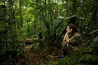 Kim Bostwick listens for manakins<br /><br />Tiputini Biodiversity Station, Amazon Rain Forest, Ecuador.