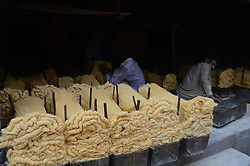 June 15, 2017 - Lahore, Punjab, Pakistan - Pakistani workers spreading the thin vermicelli ( Sevaian) for drying at a factory in the holy fasting month  of Ramzan purpose, prepared for the upcoming Eidul Fit. Muslims all over the world used to make a traditional sweet dish 'sheerkhurma'popular during the Islamic holy month of Ramadan. (Credit Image: © Rana Sajid Hussain/Pacific Press via ZUMA Wire)