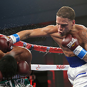 KISSIMMEE, FL - MARCH 06:  Jonathan Oquendo (R) lands a punch to the head of Gabino Cota as they fight for the WBO Latino Flyweight Title during the Telemundo Boxeo boxing match at the Kissimmee Civic Center on March 6, 2015 in Kissimmee, Florida. Oquendo won the belt after a 10 round unanimous decision on the scorecards. (Photo by Alex Menendez/Getty Images) *** Local Caption *** Jonathan Oquendo; Gabino Cota