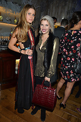 LONDON, ENGLAND 1 DECEMBER 2016: Irene Forte, Pips Taylor Left to right, at the Smythson & Brown's Hotel Christmas Party held at Brown's Hotel, Albemarle St, Mayfair, London, England. 1 December 2016.