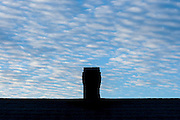 Changing skies, clouds, weather and times of day around a Smokeless Chimney