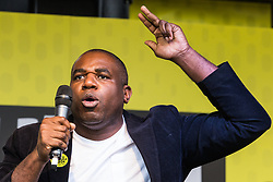 London, UK. 23rd March, 2019. David Lammy, Labour MP for Tottenham, addresses a million people taking part in a People's Vote rally in Parliament Square following a march from Park Lane.
