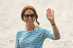 The Duchess of Cambridge waves to the crowd after taking part in a rowing race between teams representing the twinned towns of Heidelberg and Cambridge in Heidelberg, Germany, on day three of their five-day tour of Poland and Germany.