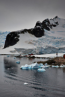 Panorama of Paradise Harbor and Brown Station (Estación Científica Almirante Brown) in Antarctica from the Deck of the Hurtigruten MS Fram. (8 of 16) Image taken with a Fuji X-T1 camera and Zeiss 32 mm f/1.8 lens (ISO 200, 32 mm, f/16, 1/500 sec). Raw images processed with Capture One Pro, Focus Magic, Photoshop CC 2015, and AutoPano Giga Pro