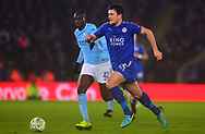 Harry Maguire of Leicester in action with Yaya Toure of Manchester City chasing .Carabao Cup quarter final match, Leicester City v Manchester City at the King Power Stadium in Leicester, Leicestershire on Tuesday 19th December 2017.<br /> pic by Bradley Collyer, Andrew Orchard sports photography.