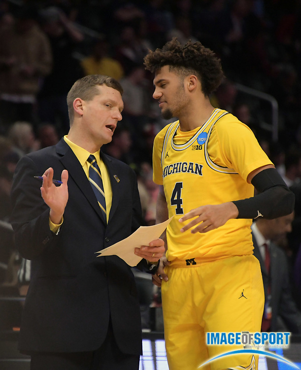 Michigan Wolverines assistant coach Luke Yaklich (left) talks with forward Isaiah Livers (4) during a West Regional semifinal of the NCAA men's college basketball tournament, Thursday, March 22, 2018, in Los Angeles. Michigan defeated Texas A&M 99-72.