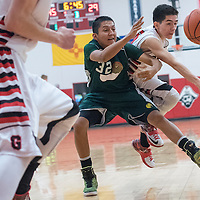 121814       Cable Hoover<br /> <br /> Grants Pirate Eric Gonzales (15) and Thoreau Hawk <br /> Nathan Francisco (32) scramble after a loose ball during the first round of the Eddie Pena Holiday Classic Thursday at Grants High School.