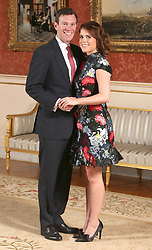 File photo dated 22/01/2018 of Princess Eugenie and Jack Brooksbank at Buckingham Palace in London after they announced their engagement, as some 800 people, 200 more than at Harry and Meghan's nuptialsÐ will gather in St George's Chapel, and attend the afternoon reception afterwards, hosted by the Queen in St George's Hall.