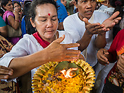 20 SEPTEMBER 2015 - SARIKA, NAKHON NAYOK, THAILAND:  People pray at the Ganesh festival at Shri Utthayan Ganesha Temple in Sarika, Nakhon Nayok. Ganesh Chaturthi, also known as Vinayaka Chaturthi, is a Hindu festival dedicated to Lord Ganesh. Ganesh is the patron of arts and sciences, the deity of intellect and wisdom -- identified by his elephant head. The holiday is celebrated for 10 days. Wat Utthaya Ganesh in Nakhon Nayok province, is a Buddhist temple that venerates Ganesh, who is popular with Thai Buddhists. The temple draws both Buddhists and Hindus and celebrates the Ganesh holiday a week ahead of most other places.   PHOTO BY JACK KURTZ