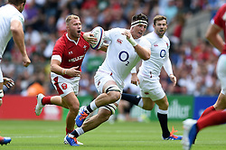Tom Curry of England takes on the Wales defence - Mandatory byline: Patrick Khachfe/JMP - 07966 386802 - 11/08/2019 - RUGBY UNION - Twickenham Stadium - London, England - England v Wales - Quilter International