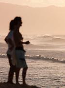 People overlooking Banzai Pipeline, a surf reef break in Pupukea, O'Ahu, Hawai'i