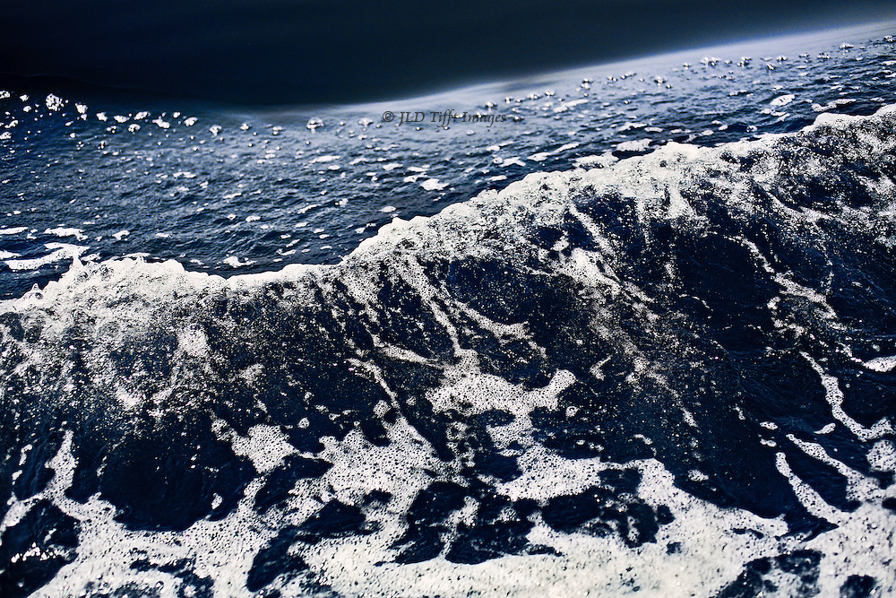 """Deep bow wave, recalling Homer's """"wine dark sea"""" as it forms an abstract foamy diagonal."""