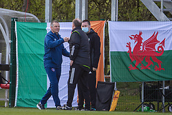 WREXHAM, WALES - Friday, March 26, 2021: Republic of Ireland's Under-21 manager Jim Crawford (L) fist bumps Wales' Under-21 head coach Paul Bodin during an Under-21 international friendly match between Wales and Republic of Ireland at Colliers Park. Republic of Ireland won 2-1. (Pic by David Rawcliffe/Propaganda)