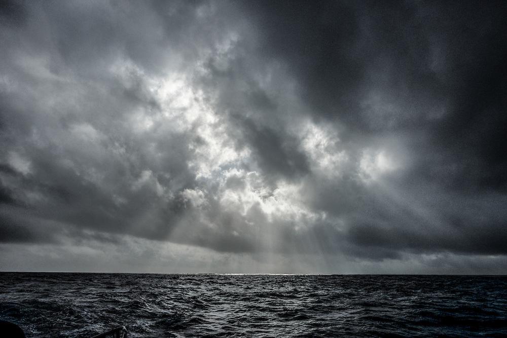 November 25, 2014. Leg 2 onboard Team SCA. The sun breaks through on a grey day.