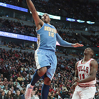 08 November 2010: Denver Nuggets' small forward #15 Carmelo Anthony goes for the lay upe past Chicago Bulls' shooting guard #11 Ronnie Brewer during the Chicago Bulls 94-92 victory over the Denver Nuggets at the United Center, in Chicago, Illinois, USA.