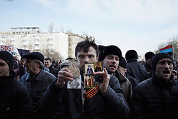 © Licensed to London News Pictures. 08/03/2014. Ukraine. Demonstration in Donetsk, Ukraine, involving groups of pro-Russia and anti-Putin protestors, in the wake of events in Kyiv.  Photo credit : Christopher Nunn/LNP