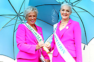 Two of the York Pink Lady Team ( Julie & Froot ) shelter from the rain prior the Countryside Raceday, October Finale at York Racecourse, York, United Kingdom on 12 October 2018. Pic Mick Atkins