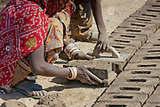Indian family forming bricks made from mud clay at Khore Bricks Factory, Rajasthan, Northern India