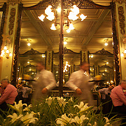 Interior of Confeitaria Colombo. .A Legacy of imperial Brazil, Confeitaria Colombo preserves the elegance of a bygone era, with it's amazing wood furniture interior. The Belle Époque tearoom opened in 1894 and attracted Rio's high society and intellectuals, and became the rendez-vous place of choice. It is also recognised for the wide selection of quality desserts on offer to customers. The Confeitaria is situated in the centre (centro) of the city. Rio de Janeiro,  Brazil. 14th September 2010. Photo Tim Clayton