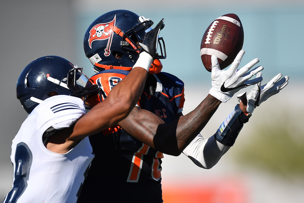 Orange Coast Pirate wide receiver James Rutledge (18) attempts to haul in a pass during the Orange Coast College vs Fullerton College football game in Costa Mesa, CA.<br /> <br /> @2016 Rick May Photography / Sports Shooter Academy - Rick May Photography