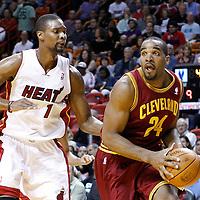 24 January 2012: Cleveland Cavaliers power forward Samardo Samuels (24) drives past Miami Heat power forward Chris Bosh (1) during the Miami Heat 92-85 victory over the Cleveland Cavaliers at the AmericanAirlines Arena, Miami, Florida, USA.