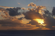 Dramatic view of Saba and clouds at sunset from St. Barthelemy