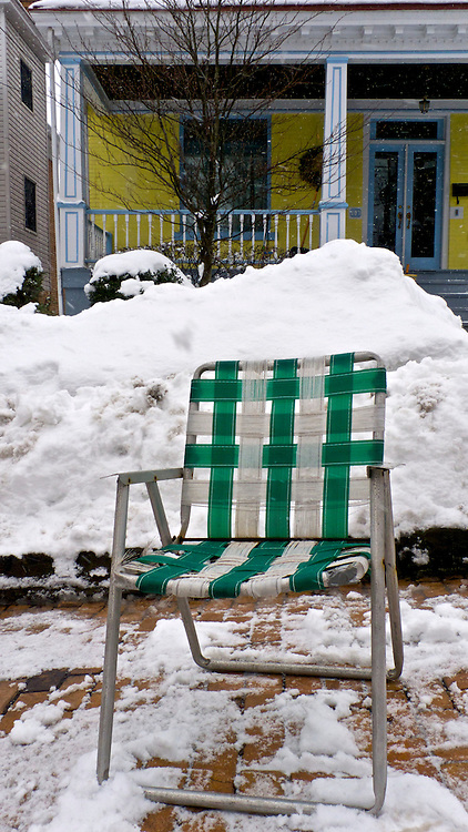 Parking spot reserved with chair on Whitney Avenue in Wilkinsburg, PA.
