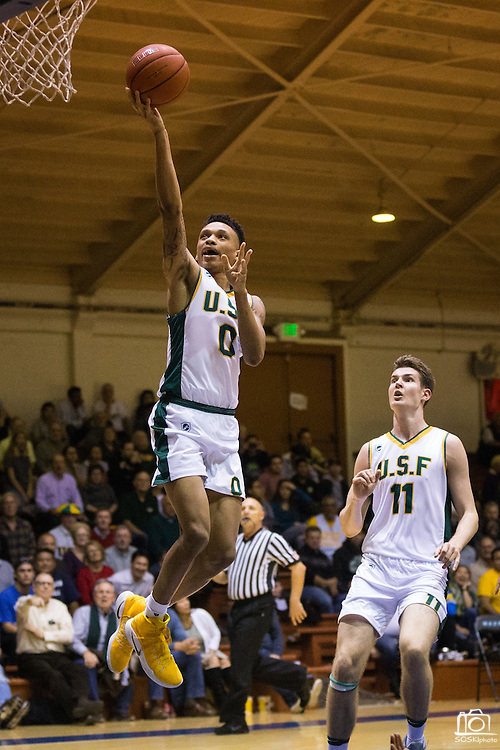 San Francisco Dons guard Marquill Smith (0) attacks the basket against the San Francisco State University Gators at Kezar Pavilion in San Francisco, Calif., on December 6, 2016. (Stan Olszewski/Special to S.F. Examiner)