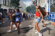 The 49th Notting Hill Carnival in West London. A celebration of West Indian / Caribbean culture and Europe's largest street party, festival and parade. Revellers come in their hundreds of thousands to have fun, dance, drink and let go in the brilliant atmosphere.