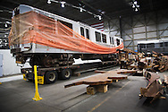 A Path Train car is on of the artifacts chosen by curators out of the wreckage  from the World Trade Center  stored temporarily within an 80,000 square foot hanger at JFK airport, Hanger 17 . Some of the artifacts will be in the National September 11 Memorial Museum set to open in 2012.