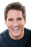 one  man mature handsome man laughing portrait studio white background