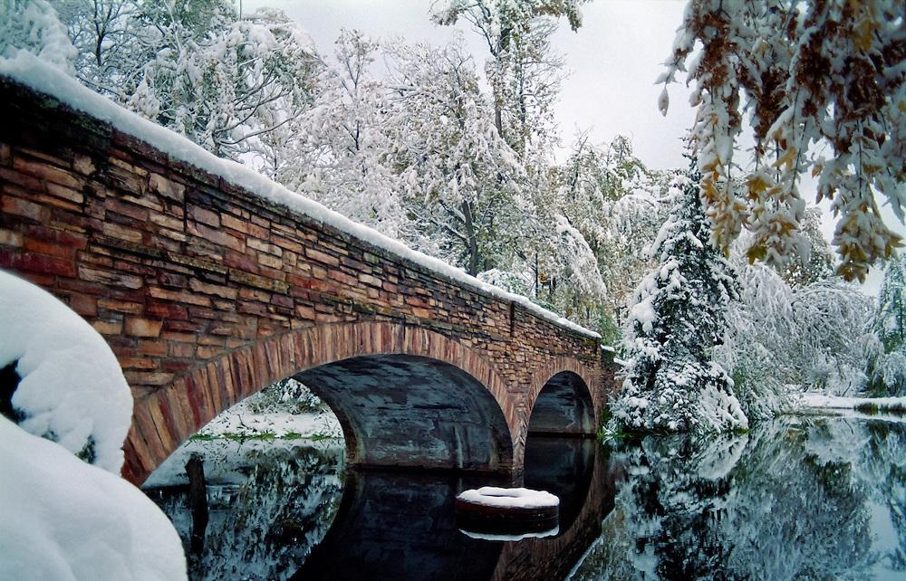 Brick bridge across Varsity Lake in winter, University of Colorado campus, Boulder, Colorado.