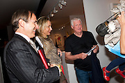 SIMON DE PURY; MICHAELA DE PURY;  DR FRIEDRICH-CHRISTIAN FLICK, Pavilion of art and design.- PAD London  Berkeley Square. London. 10 October 2011. <br /> <br />  , -DO NOT ARCHIVE-© Copyright Photograph by Dafydd Jones. 248 Clapham Rd. London SW9 0PZ. Tel 0207 820 0771. www.dafjones.com.